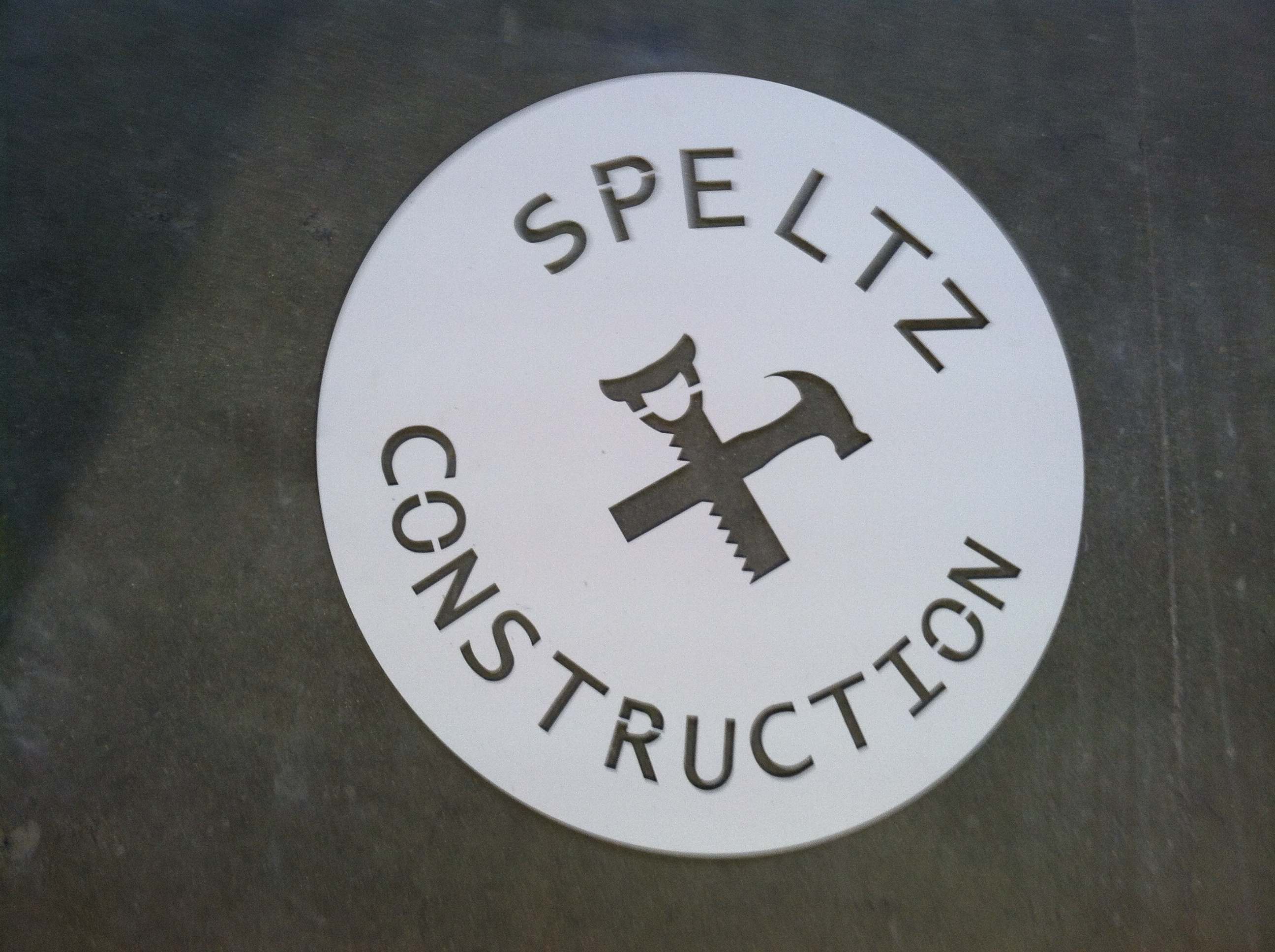 Metal sign of Speltz Construction